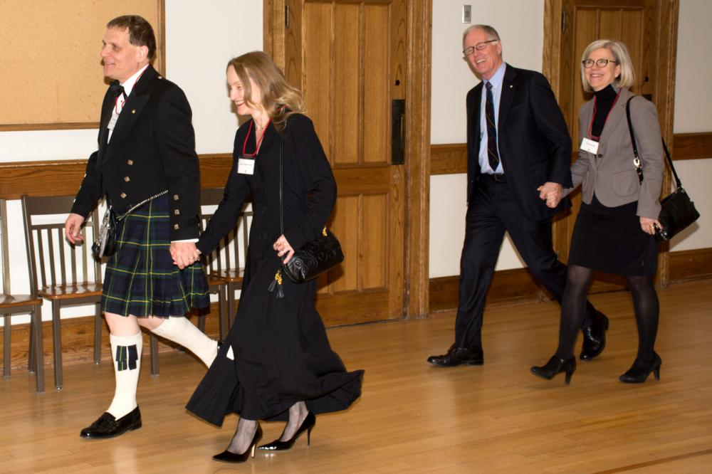 [Daniel Woolf, dressed in a kilt, being piped into a dinner celebrating hte installation of Queen's newest Chancellor, Jim Leech]