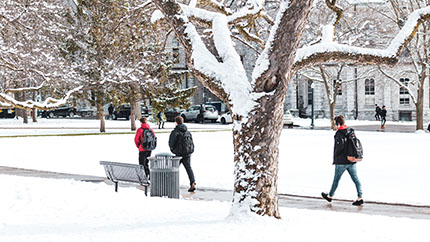 Students make their way along the wintry paths at Queen's University