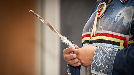 [person holding feather]