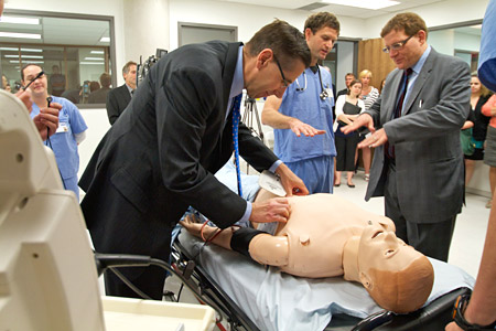 [Daniel Woolf, with medical students and Education Minister John Molloy, on a tour of the simulation lab in the new School of Medicine building]