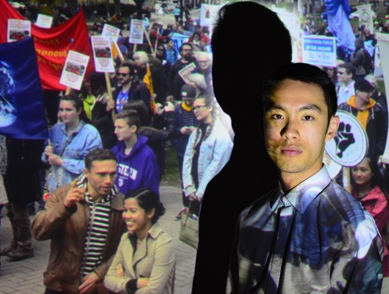 young man with projection of protest